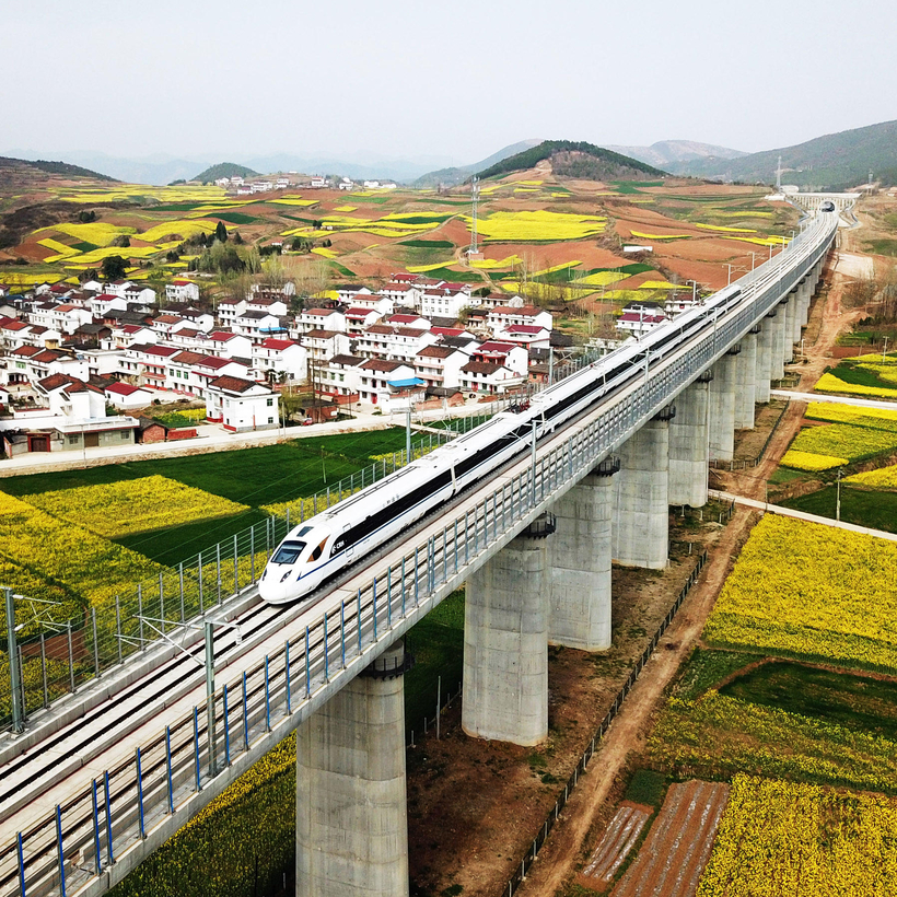 A bullet train speeds through the Yangxian section of the Xi'an-Chengdu high-speed railway line, in northwest China's Shaanxi Province, March 2018.