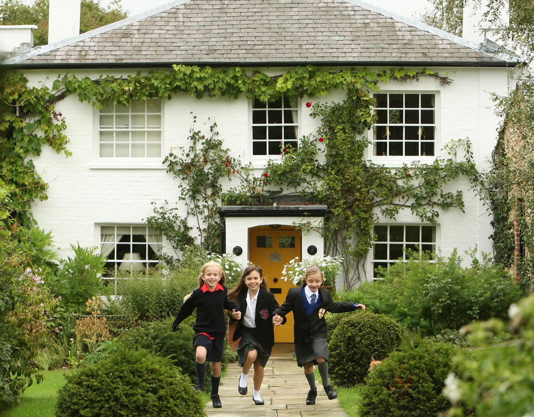 Josie Griffiths, Adrianna Bertola, and Kerry Ingram, who starred in the Royal Shakespeare Company's Matilda: A Musical, outside Roald Dahl's home in Great Missenden, England, 2010.