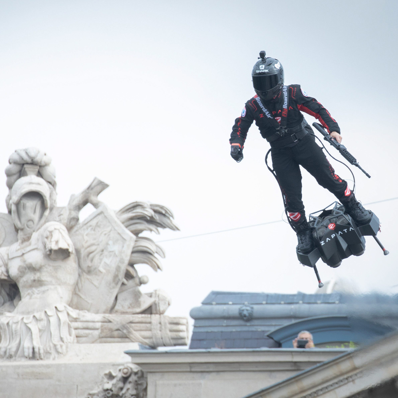 Franky Zapata flies over Paris with an assault rifle to demonstrate the military uses of Flyboards on Bastille Day, 2019.