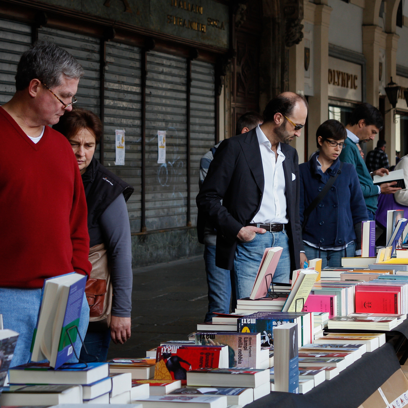 At the annual Turin book fair, a mile-long display of books under the arcades.