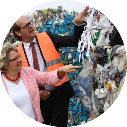 "North Rhine-Westphalia summer tour with Svenja Schulze12 July 2018, Germany, Gescher: Federal Environmental Minister Svenja Schulze (L) Social Democratic Party (SPD), and Stephan Eing, CEO of ""Eing Kunststoffverwertung"", standing during a visit of a facility for the sorting and recycling of plastic waste."