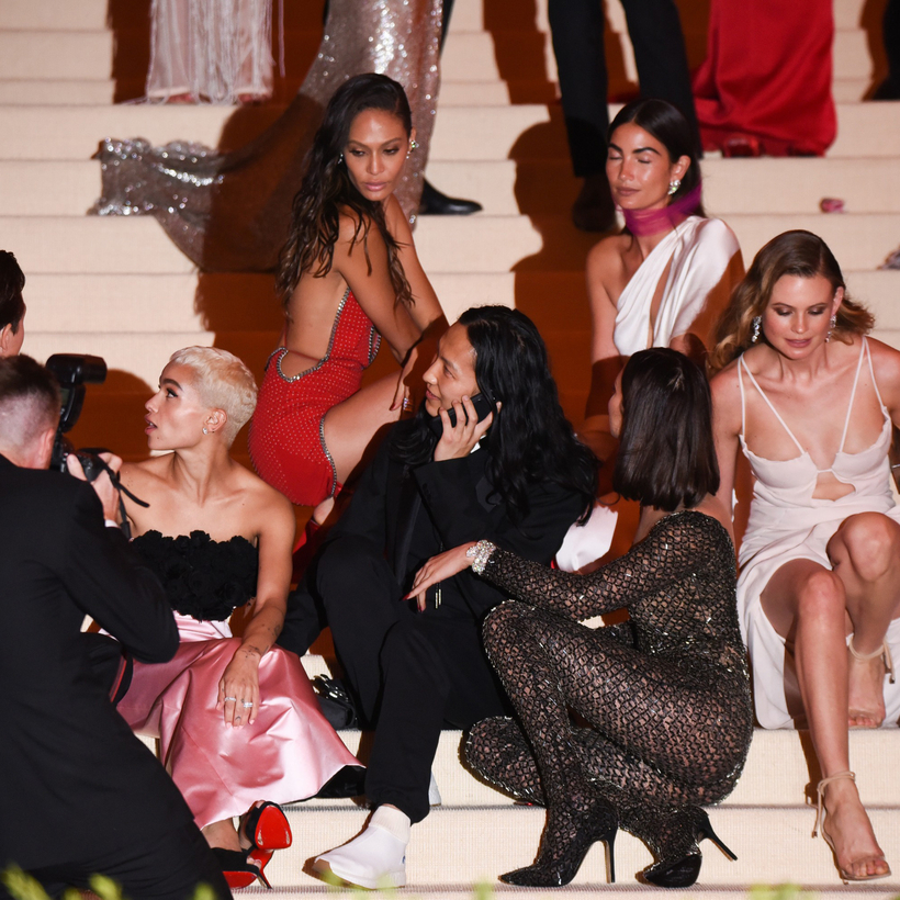 Alexander Wang surrounded by (from left) Zoë Kravitz, Joan Smalls, Lily Aldridge, Behati Prinsloo, and, in front, Bella Hadid, at the 2017 Costume Institute Gala at the Metropolitan Museum of Art.