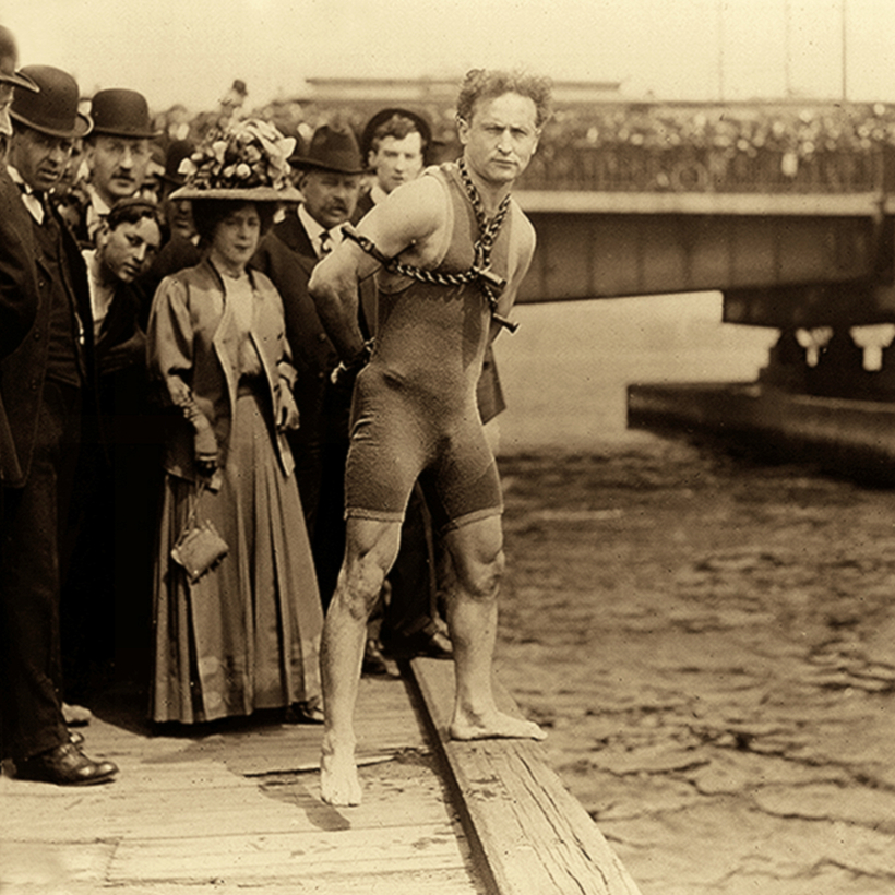 Not the old ball and chain: Harry Houdini performs a magic trick in New York Harbor.
