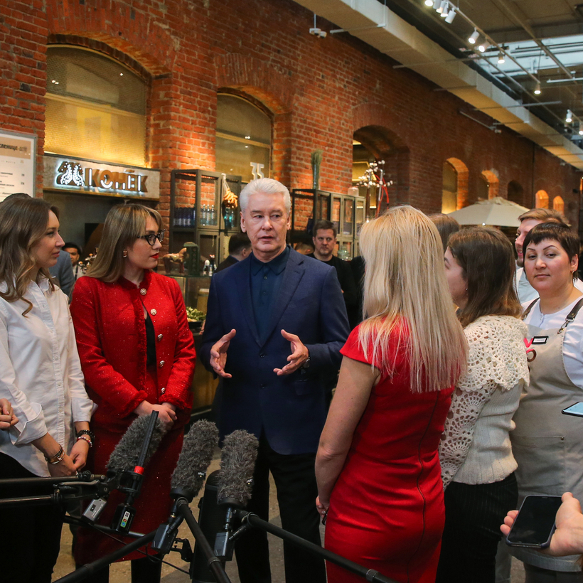 Moscow mayor Sergei Sobyanin, third from left, visits the Depo (depot) food mall.
