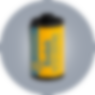 A 20 exposure roll of Kodak Ektachrome slide film and its yellow metal canister with it color coded blue screw top lid, 2018